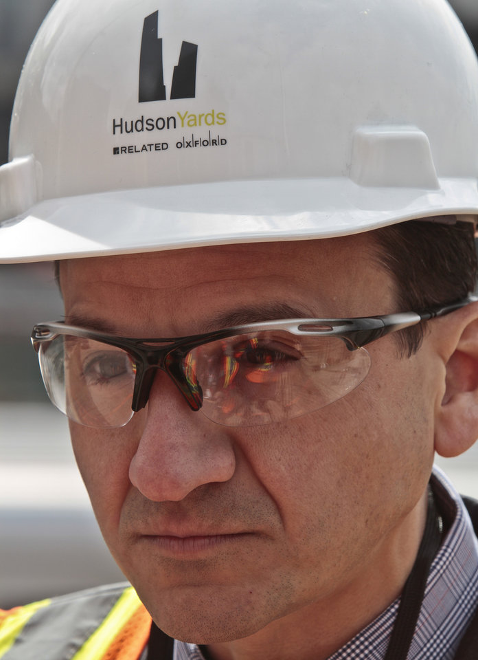 Photo - Michael Samuelian, right, Hudson Yards project director for planning and architecture, listens during an interview on the project site site, Thursday April 17, 2014 in New York. The $15 billion Hudson Yards will fill 28 acres between the Hudson River and Tenth Avenue with six skyscrapers. (AP Photo/Bebeto Matthews)