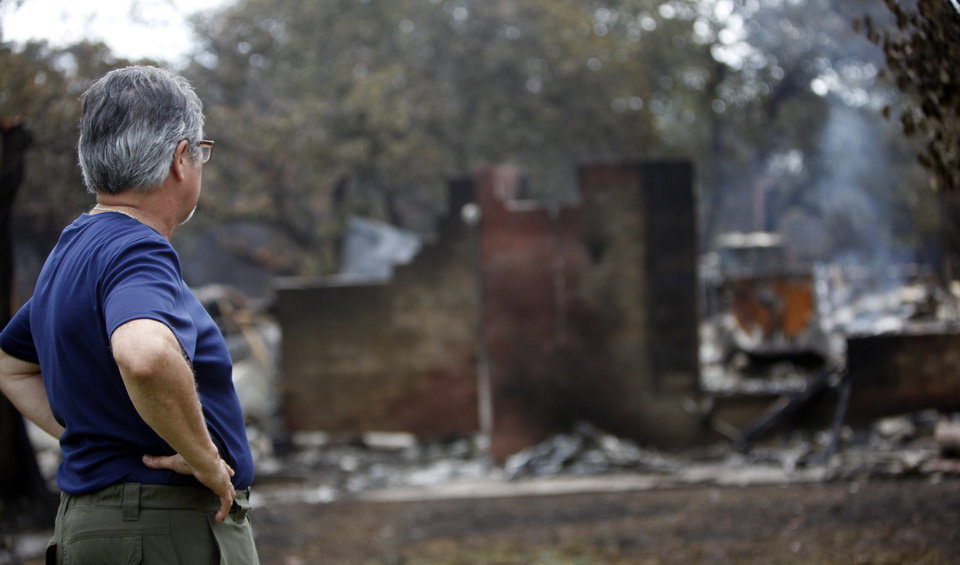 Joel Rodriguez watches hotspots burn at his home Blackjack Lane in Edmond, Okla.,  Sunday, Aug. 7, 2011. Photo by Sarah Phipps, The Oklahoman