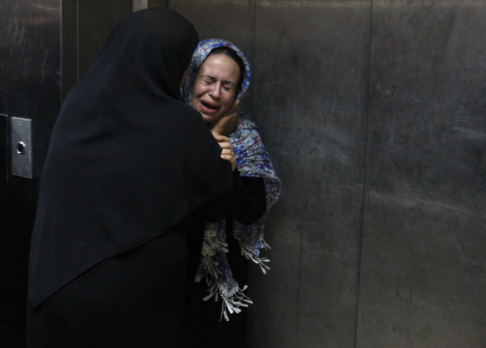 Photo -   A Palestinian woman cries at a hospital in Gaza City, Saturday, Nov. 10,2012. An explosion targeted an Israeli military vehicle on Jewish state's border with Gaza on Saturday and Israeli troops fired into the Palestinian territory, killing several civilians and wounding at least 25, Gaza officials and witnesses said. (AP Photo/Hatem Moussa)