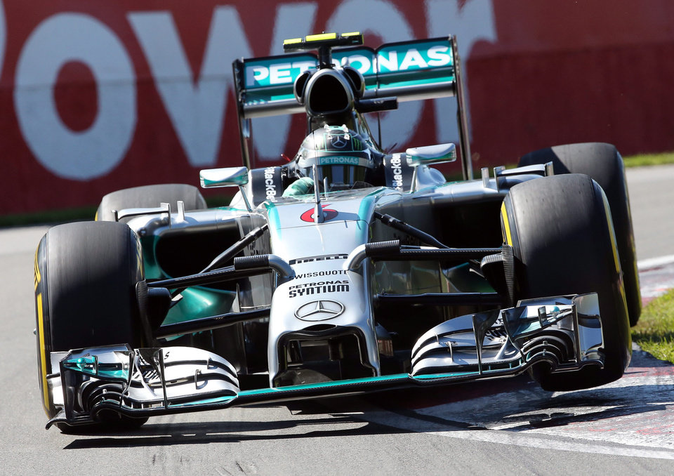 Photo - Mercedes driver Nico Rosberg from Germany goes over a curb during the morning practice session at Circuit Gilles Villeneuve Saturday, June 7, 2014 in Montreal. Rosberg will start from pole position in the Canadian Grand Prix Sunday, June 8, 2014.  (AP Photo/The Canadian Press, Tom Boland)