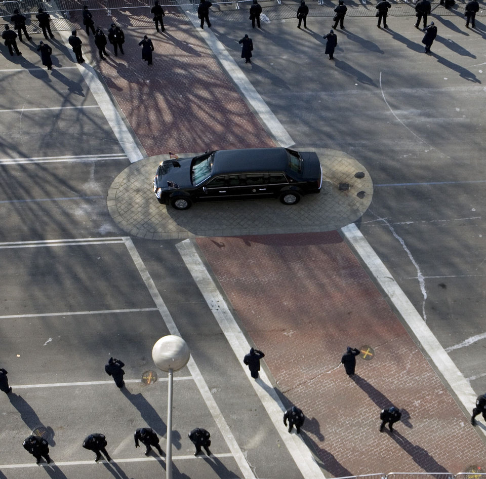 Photo - The limousine carrying President Bush and President-elect Barack Obama is driven along Pennsylvania Avenue toward the U.S. Capitol for the presidential inauguration, Tuesday, Jan. 20, 2009, in Washington. (AP Photo/Haraz N. Ghanbari)