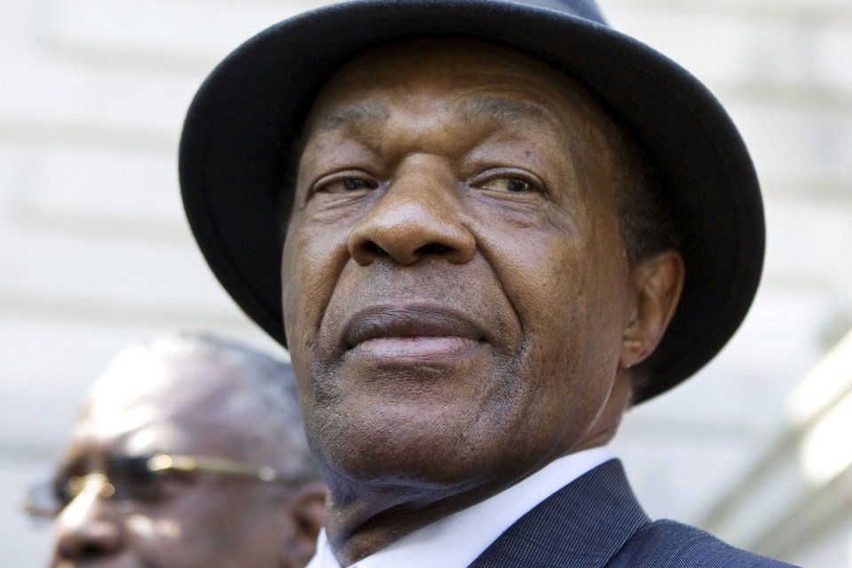 Photo - FILE - In this July 6, 2009 file photo, former District of Columbia Mayor Marion Barry attends a news conference on the steps of Washington's city hall. Barry was famously caught on videotape smoking crack cocaine in 1990 in an FBI sting. After six months in prison, he was released and won a seat on the city council. He was re-elected to a fourth term as mayor in 1994.  (AP Photo/Manuel Balce Ceneta, File)