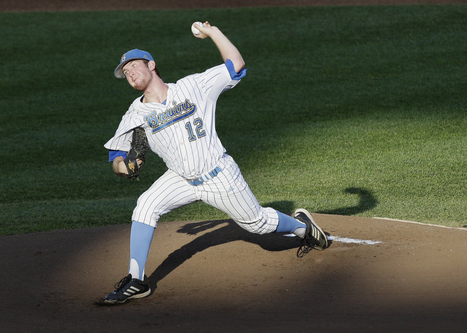 UCLA starting pitcher Grant Watson works against North Carolina in the first inning of an NCAA College World Series baseball game in Omaha, Neb., Friday, June 21, 2013. (AP Photo/Nati Harnik)