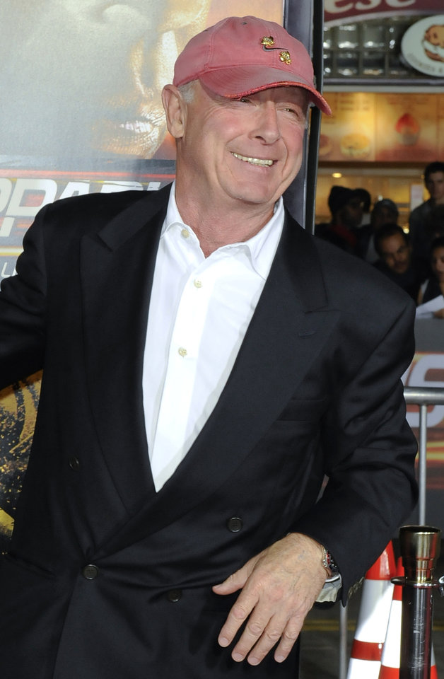 Photo -   FILE - In this Oct. 26, 2010 file photo, director Tony Scott arrives at the premiere of