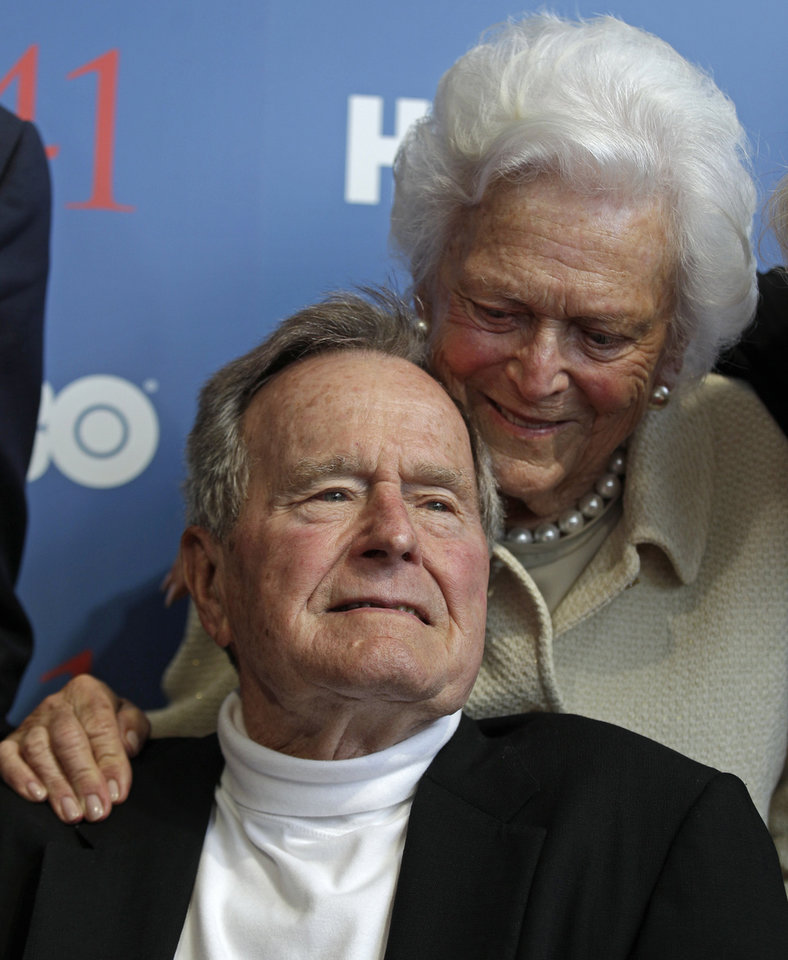 Photo - FILE - In this Tuesday, June 12, 2012 file photo, President George H.W. Bush, and his wife, Barbara, arrive for the premiere of HBO's new documentary about his life in Kennebunkport, Maine. A criminal investigation is under way after a hacker apparently accessed private photos and emails sent between members of the Bush family, including both former presidents, according to reports Friday, Feb. 8, 2013.  (AP Photo/Charles Krupa, File)