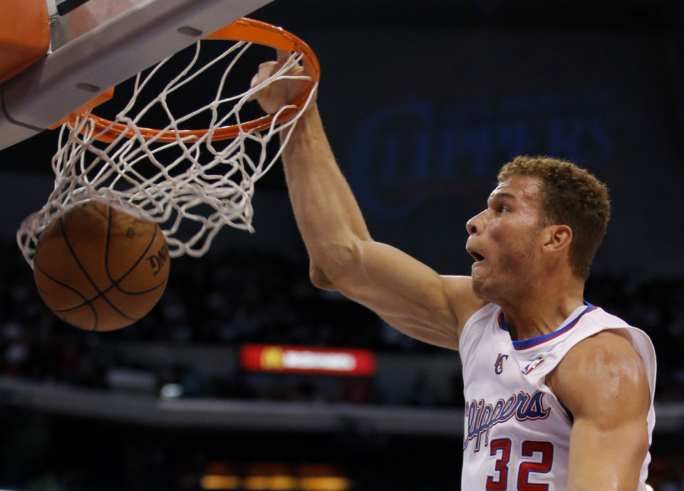 Los Angeles Clippers' Blake Griffin dunks in the first half of an NBA basketball game against the Chicago Bulls in Los Angeles, Saturday, Nov. 17, 2012. (AP Photo/Jae C. Hong) ORG XMIT: LAS105