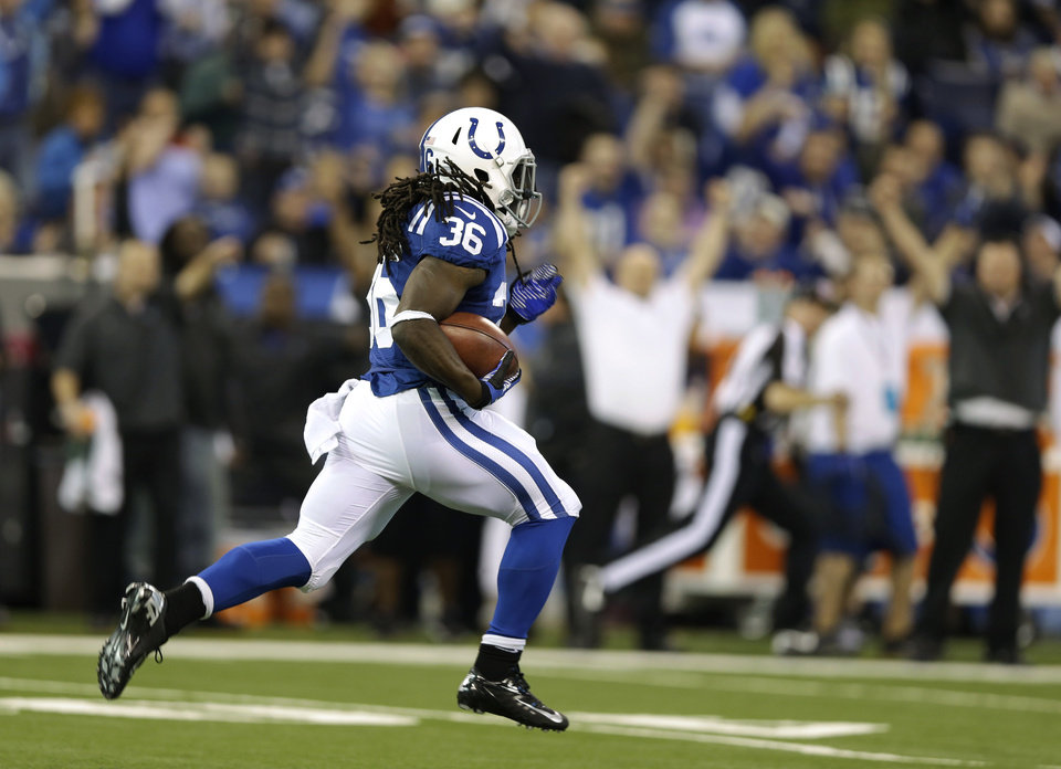 Photo - Indianapolis Colts' Deji Karim runs back a kickoff 101 yards for a touchdown during the second half of an NFL football game against the Houston Texans, Sunday, Dec. 30, 2012, in Indianapolis. (AP Photo/Michael Conroy)