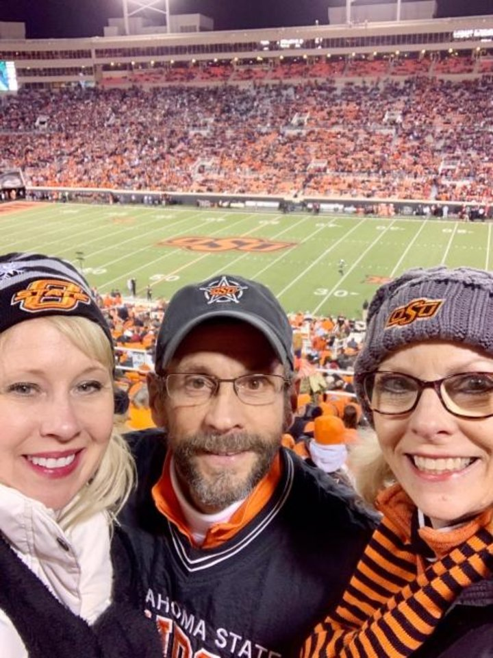Photo -  Janis Hutson Reeser, right, seen last season with her brother and sister in law Jeff and Julie Hutson, has been an OSU football season-ticket holder for more than 35 years. But Reeser opted out of her seats because of the uncertainty of the coronavirus pandemic. [PHOTO PROVIDED]