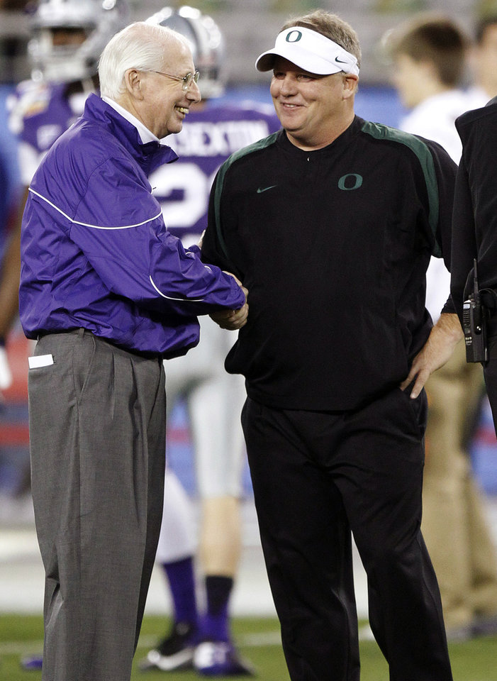 Photo - Kansas State head coach Bill Snyder, left, shakes hands with Oregon head coach Chip Kelly before the Fiesta Bowl NCAA college football game, Thursday, Jan. 3, 2013, in Glendale, Ariz. (AP Photo/Paul Connors)