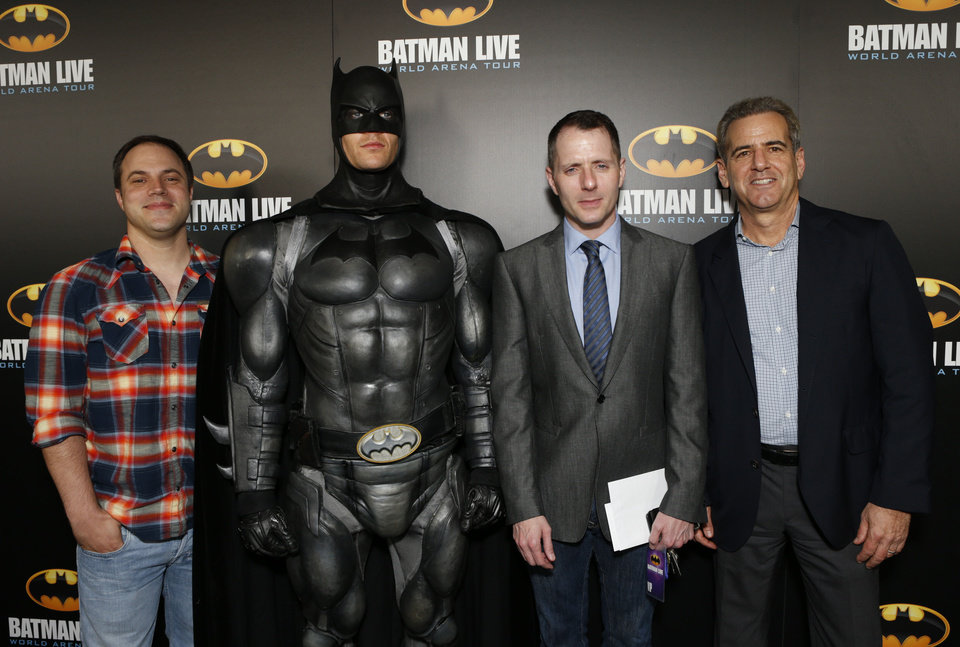 "Posing with Batman, second from left, are Geoff Johns, chief creative officer of DC Entertainment; Allan Heinberg, writer of ""Batman Live""; and Brad Globe, president, Warner Bros. Consumer Products at the Los Angeles ""Batman Live"" premiere on Sept. 27 in  Los Angeles. (Photo by Todd Williamson/Invision for Warner Bros./AP Images) <strong></strong>"