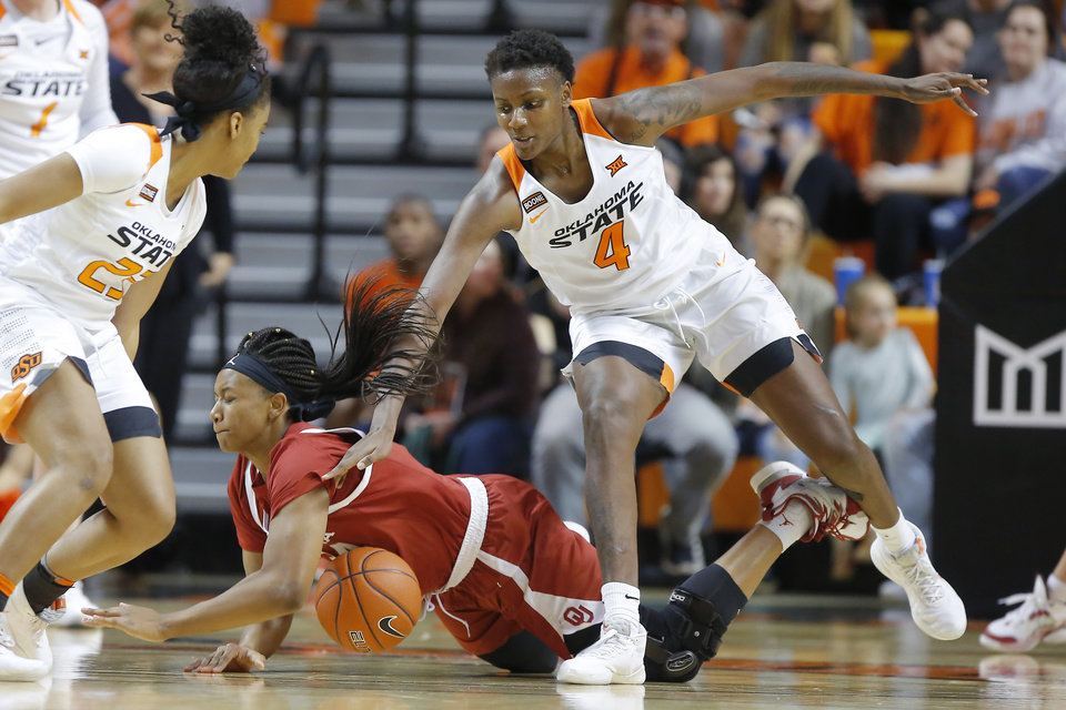Photo - Oklahoma's Liz Scott (34) dives for the ball beside Oklahoma State's Natasha Mack (4) during a women's Bedlam college basketball game between the Oklahoma State University Cowgirls (OSU) and the University of Oklahoma Sooners (OU) at Gallagher-Iba Arena in Stillwater, Okla., Wednesday, Jan. 8, 2020. [Bryan Terry/The Oklahoman]