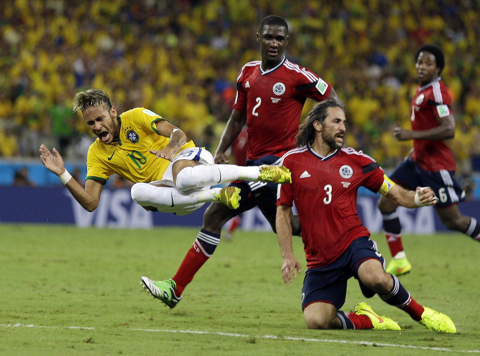 Photo - Brazil's Neymar is airborne after running in to Colombia's Mario Yepes during the World Cup quarterfinal soccer match between Brazil and Colombia at the Arena Castelao in Fortaleza, Brazil, Friday, July 4, 2014. (AP Photo/Natacha Pisarenko)