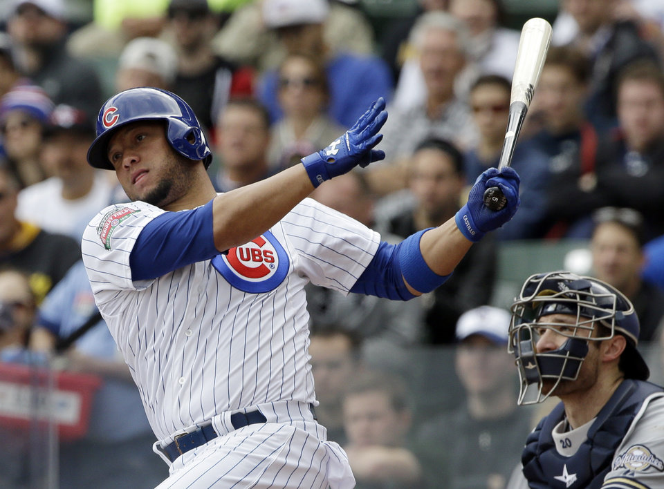 Photo - Chicago Cubs' Welington Castillo hits a two-run double during the first inning of a baseball game against the Milwaukee Brewers in Chicago, Saturday, May 17, 2014. (AP Photo/Nam Y. Huh)