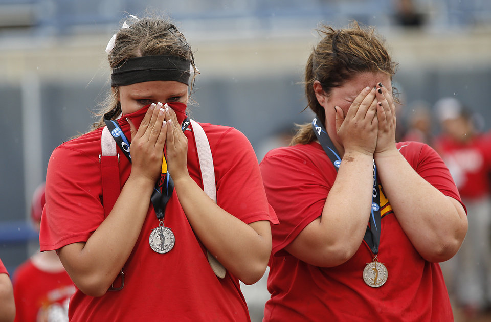 Photo - Dale's Sam Barry and McKenzie Stith, from left, react after the loss to Tushka in the Class 4A Oklahoma State High School Slow Pitch Softball Championship at ASA Hall of Fame Stadium in Oklahoma City, Wednesday, May 1, 2013. Photo by Chris Landsberger, The Oklahoman