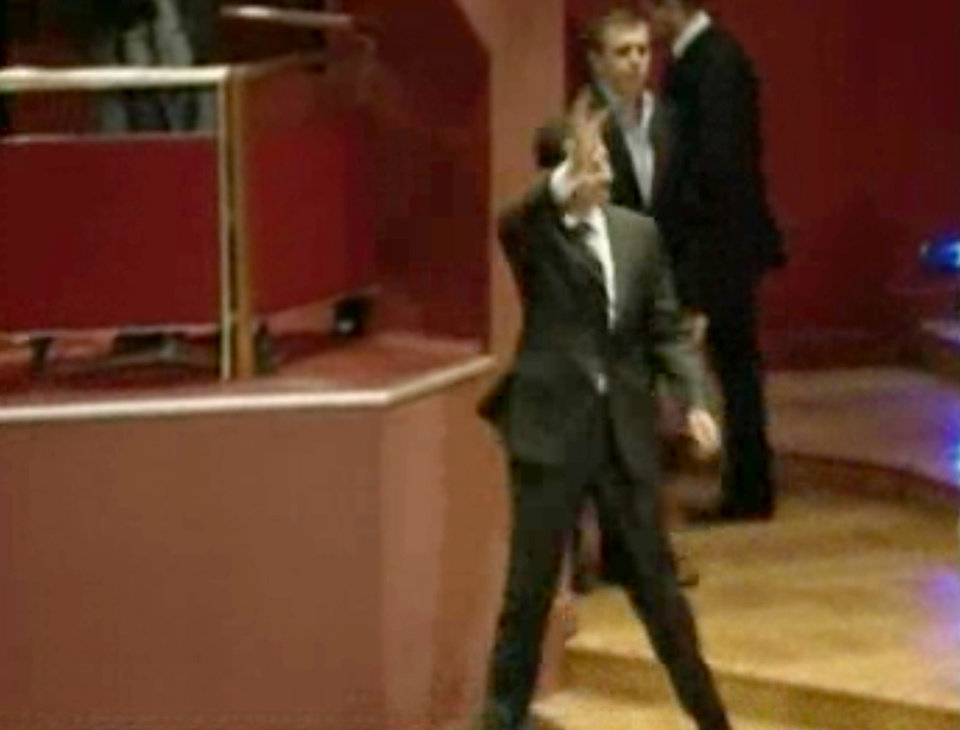 In this image taken from video obtained from Syrian State Television, which has been authenticated based on its contents and other AP reporting, Syrian President Bashar Assad waves before speaking at the Opera House in central Damascus, Syria, Sunday, Jan. 6, 2013. Syrian President Bashar Assad on Sunday outlined a new peace initiative that includes a national reconciliation conference and a new government and constitution but demanded regional and Western countries stop funding and arming rebels first. (AP Photo/Syrian State Television via AP video)