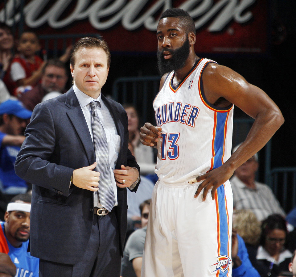 Photo - Oklahoma City head coach Scott Brooks talks with James Harden (13) during the NBA basketball game between the Detroit Pistons and Oklahoma City Thunder at the Chesapeake Energy Arena in Oklahoma City, Monday, Jan. 23, 2012. Oklahoma City won, 99-79. Photo by Nate Billings, The Oklahoman
