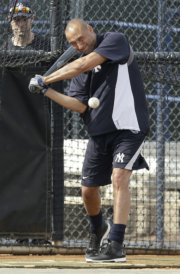 Photo - New York Yankees shortstop Derek Jeter swings at a pitch during practice at the Yankees' minor league facility  Wednesday, Feb. 12, 2014, in Tampa, Fla. Jeter says he will retire after this season. Jeter posted a long letter on his Facebook account Wednesday, Feb. 12, 2014,  saying the 2014 will be his last year playing professional baseball.(AP Photo/Chris O'Meara)
