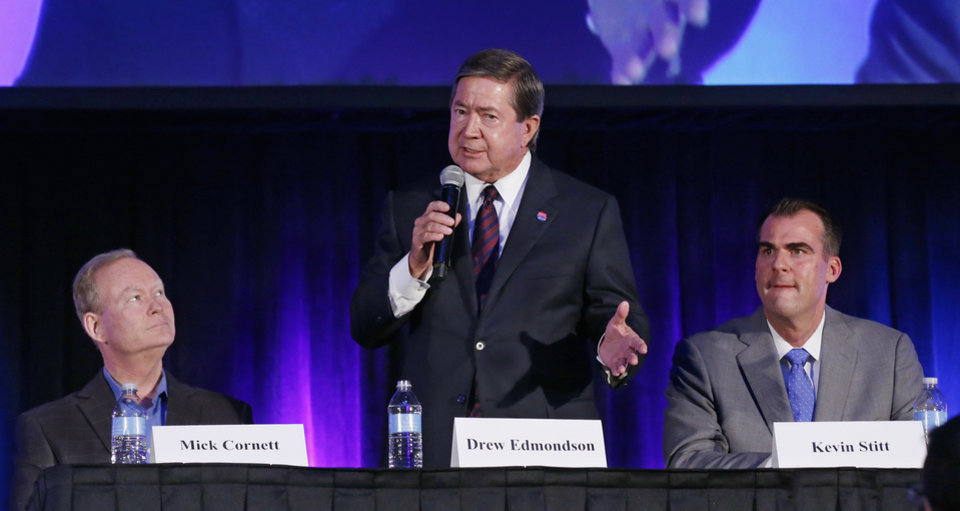 Photo - Oklahoma Democratic gubernatorial candidate Drew Edmondson speaks during a candidate forum in Oklahoma City, Friday, Aug. 24, 2018. Looking on are Republican candidates Mick Cornett, left, and Kevin Stitt, right. Cornett and Stitt face each other in the Republican runoff election on Aug. 28, 2018. Edmondson will face the winner in November. (AP Photo/Sue Ogrocki)