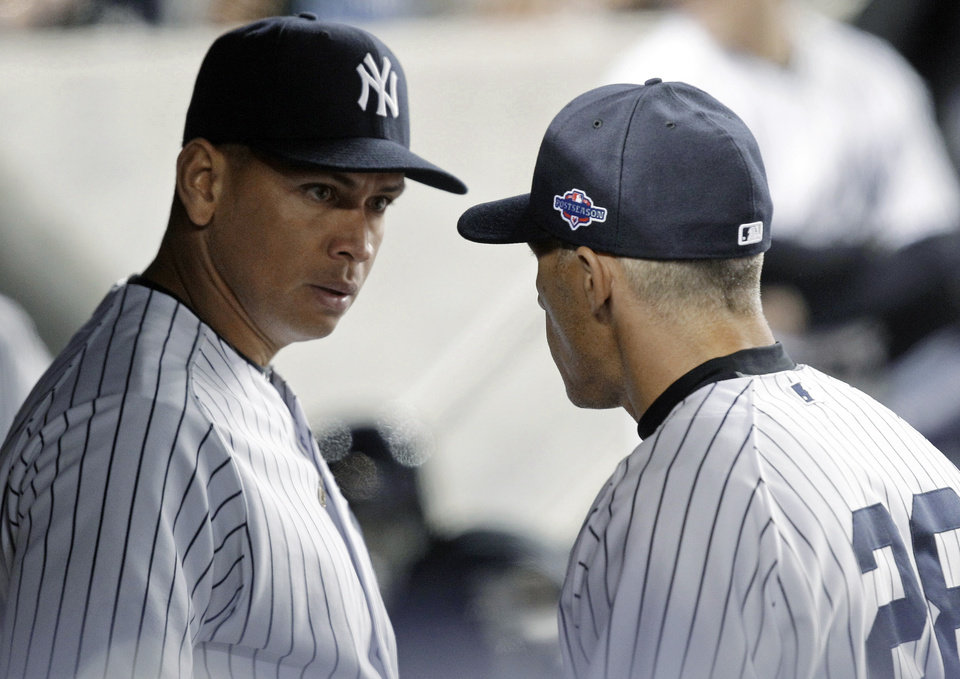 New York Yankees\' Alex Rodriguez, left, talks to manager Joe Girardi during the 10th inning of Game 3 against the Baltimore Orioles in the American League division baseball series Wednesday, Oct. 10, 2012, in New York. (AP Photo/Kathy Willens)