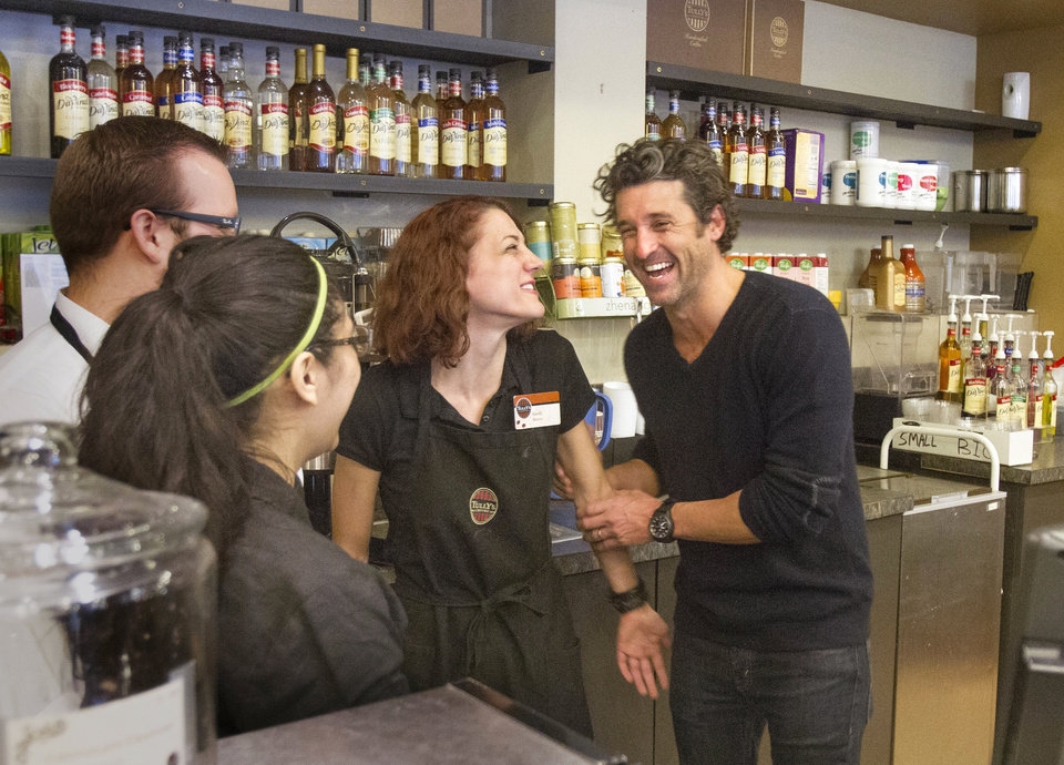 Photo - Patrick Dempsey's investment group has won the bid to purchase Tully's Coffee. Dempsey meets the staff at the Tully's Coffee on Western Avenue near the Pike Place Market on Friday, Jan. 4, 2013. Dempsey  meets with employees from left including Stephen Loewen, Susie Campos and Sarah Paulson. (AP Photo/The Seattle Times, Mike Siegel) OUTS: SEATTLE OUT, USA TODAY OUT, MAGAZINES OUT, TELEVISION OUT, SALES OUT. MANDATORY CREDIT TO: MIKE SIEGEL/THE SEATTLE TIMES.