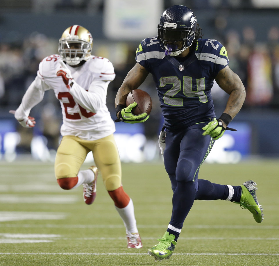 Photo - Seattle Seahawks' Marshawn Lynch breaks away for a touchdown run during the second half of the NFL football NFC Championship game against the San Francisco 49ers Sunday, Jan. 19, 2014, in Seattle. (AP Photo/Elaine Thompson)