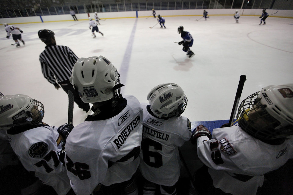 Photo - Oil Kings players watch a game Sunday between the Oklahoma City Oil Kings and the New Mexico Warriors during the Oktoberfest 2012 youth hockey tournament at Arctic Edge Arena in Oklahoma City.  Photo by Garett Fisbeck, The Oklahoman  Garett Fisbeck