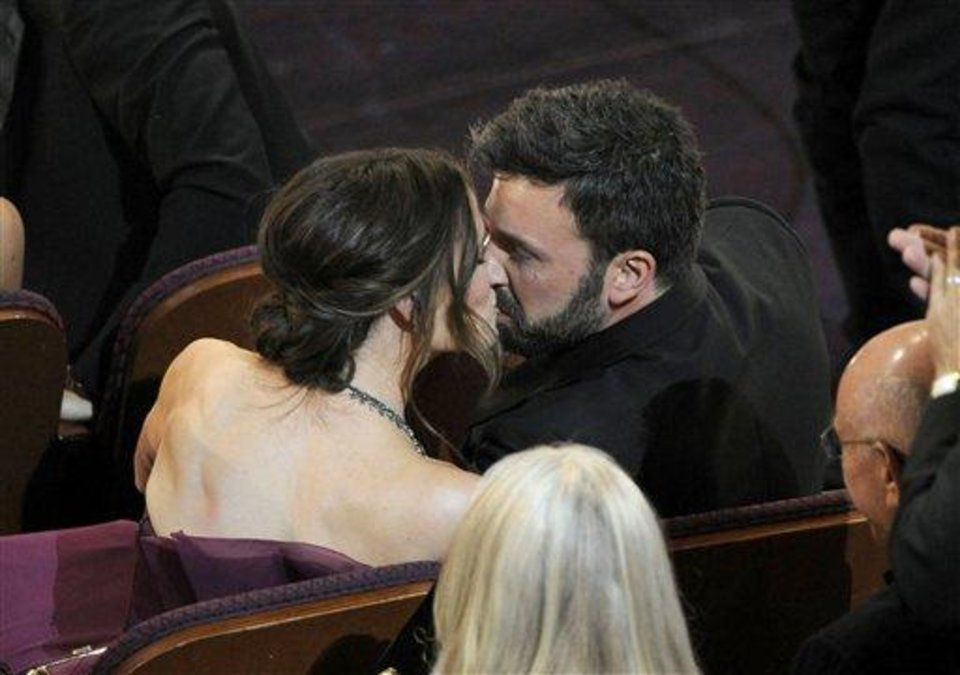 "Jennifer Garner, left, kisses husband and director Ben Affleck after ""Argo"" is announced the winner for the award for best picture during the Oscars at the Dolby Theatre on Sunday Feb. 24, 2013, in Los Angeles.  (Photo by Chris Pizzello/Invision/AP)"