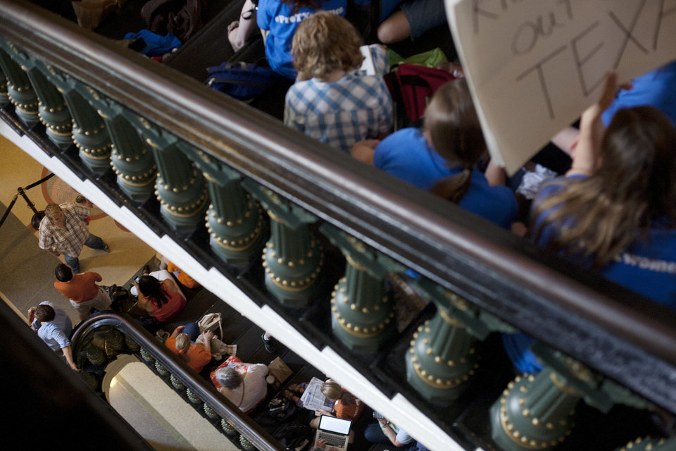 Photo - Hundreds wait in line to enter the Senate gallery at the Texas State Capitol in Austin, Texas, Friday, July 12, 2013. The Texas Senate leader, Lt. Gov. David Dewhurst, has scheduled a vote for Friday on the same restrictions on when, where and how women may obtain abortions in Texas that failed to become law after a Democratic filibuster and raucous protesters were able to run out the clock on an earlier special session. (AP Photo/Tamir Kalifa)