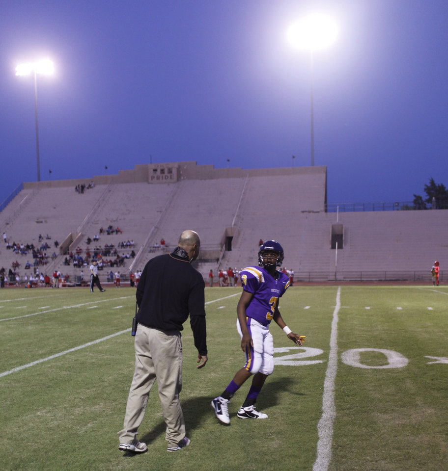 Coach Lloyd Smith sends Jalen Harris (3) in with a play at the Northwest Classen vs. Western Heights high school football game at Taft Stadium Thursday, September 20, 2012. Photo by Doug Hoke, The Oklahoman