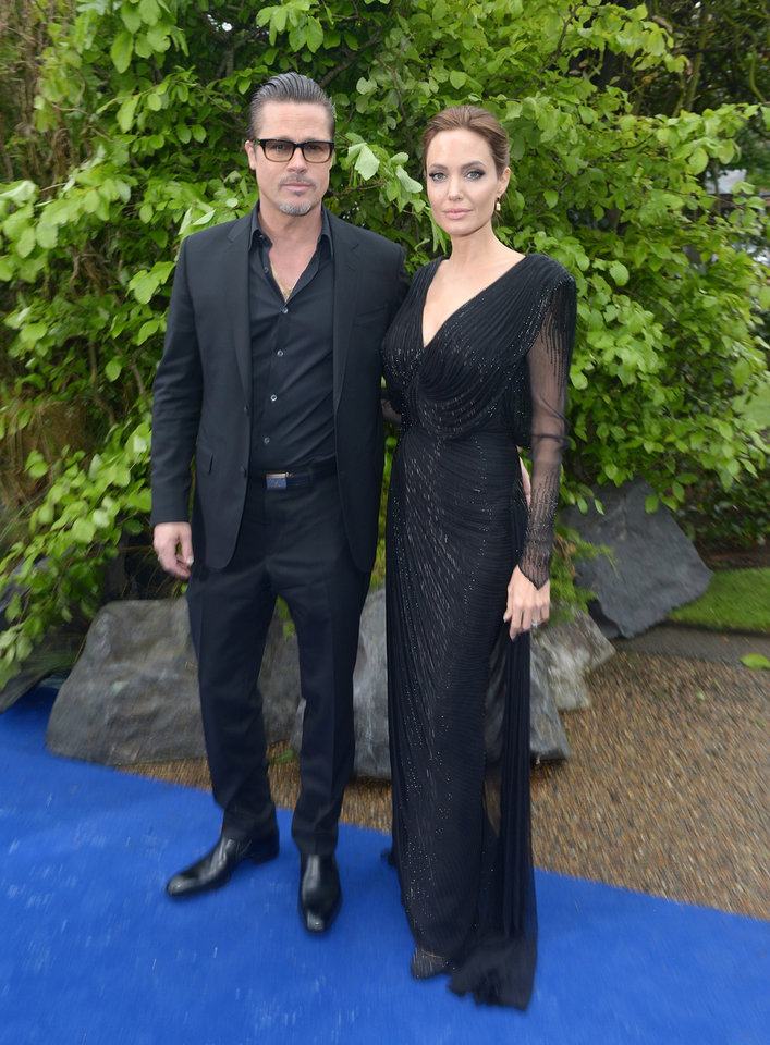 Photo - Actors Brad Pitt and Angelina Jolie arrive at the Maleficent exhibit in Kensington Gardens, London, Thursday, May 8, 2014. The exhibit showcases some of the costumes and props from the film Maleficent, before they go on display to the public at the O2 in London.(Photo by Jon Furniss/Invision/AP Images)