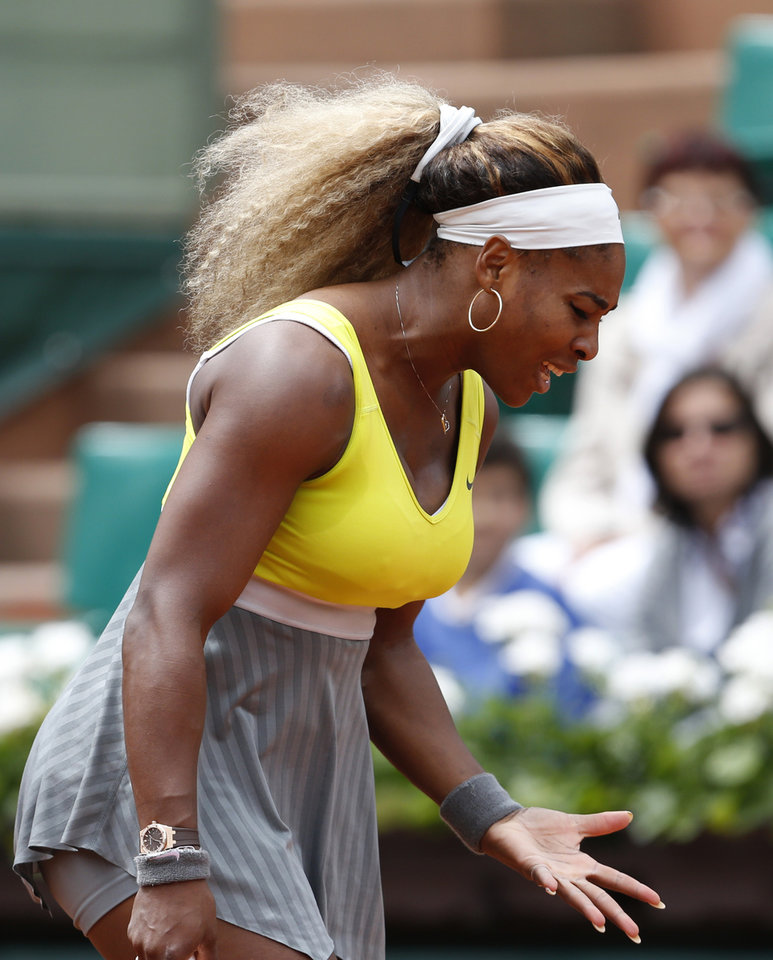 Photo - Serena Williams of the U.S. gestures after missing a return during the second round match of the French Open tennis tournament against Spain's Garbine Muguruza at the Roland Garros stadium, in Paris, France, Wednesday, May 28, 2014. (AP Photo/Darko Vojinovic)