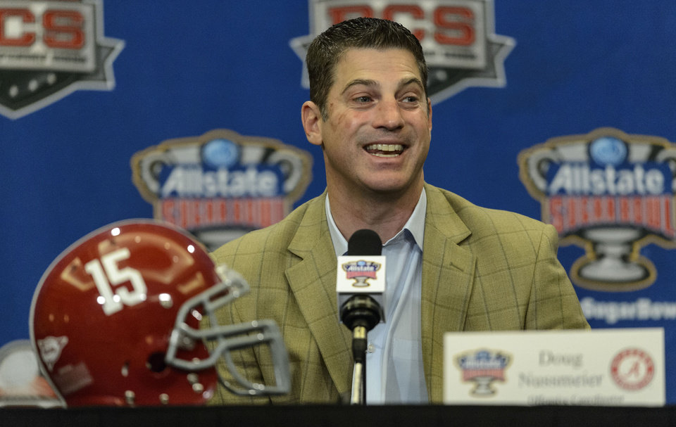 Photo - Alabama offensive coordinator/quarterbacks coach Doug Nussmeier talks with the media during an NCAA college football news conference, Sunday, Dec. 29, 2013, at the New Orleans Marriott Conventions Center in New Orleans. Alabama plays Oklahoma in the Sugar Bowl on Thursday, Jan.  2, 2014.(AP Photo/AL.com Vasha Hunt) MAGS OUT