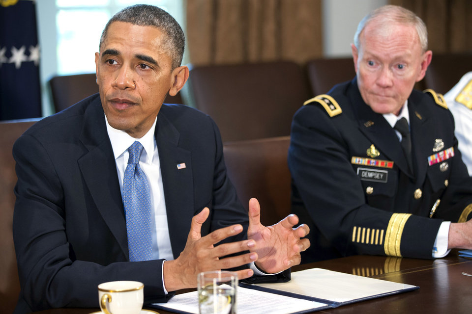 Photo - President Barack Obama speaks during a meeting with Joint Chiefs Chairman Gen. Martin Dempsey, left, Defense Secretary Chuck Hagel, and the service secretaries, service chiefs, and senior enlisted advisers to discuss sexual assault in the military in the Cabinet Room of the White House in Washington, Thursday, May 16, 2013. (AP Photo/Jacquelyn Martin)