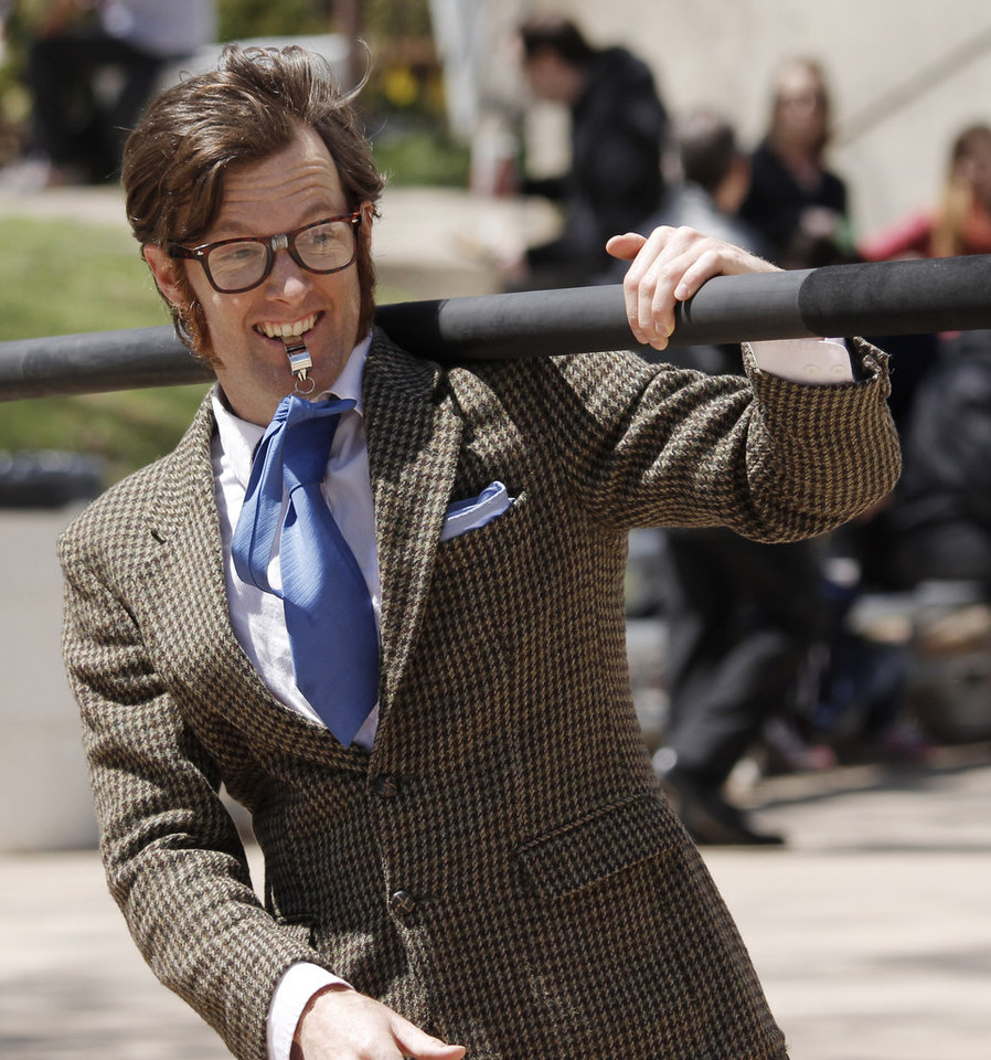 Photo - Street performer Derek McAlister performs during lunch at the Festival of the Arts in downtown Oklahoma City  Wednesday, April 24, 2013. The Hunters are from Piedmont. Photo by Doug Hoke, The Oklahoman