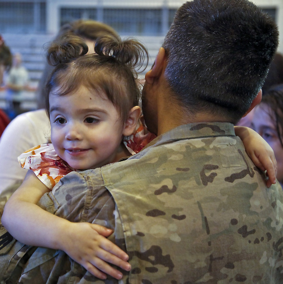 Madelyn hugs her father Staff Sgt. Orlando Ornelas during the return ceremony for the National Guard's 45th Infantry Brigade Combat Team troops at the National Guard Base on Thursday, March 15, 2012, in Oklahoma City, Oklahoma.  Photo by Chris Landsberger, The Oklahoman