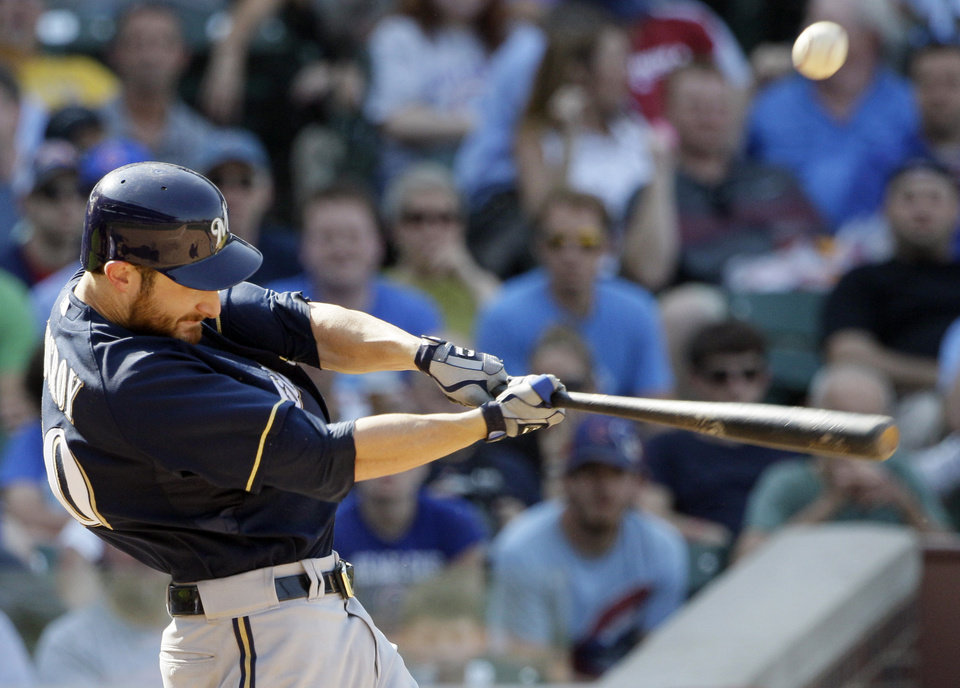 Photo -   Milwaukee Brewers' Jonathan Lucroy hits a two-run single against the Chicago Cubs during the sixth inning of a baseball game in Chicago, Thursday, Aug. 30, 2012. (AP Photo/Nam Y. Huh)