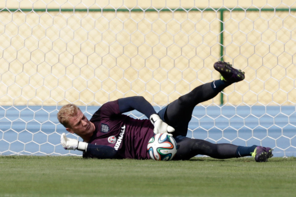 Photo - England's goalkeeper Joe Hart makes a save during a squad training session for the 2014 soccer World Cup at the Urca military base in Rio de Janeiro, Brazil, Wednesday, June 11, 2014.  The England soccer team are staying in Rio de Janeiro as their base city for the 2014 soccer World Cup.  (AP Photo/Matt Dunham)