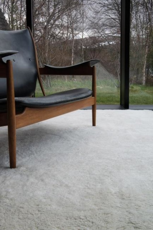 Photo -  Andrew Bowen, director of staging at ASH NYC, likes the Rug Company's Deep Pile Merino Natural Rug ($137 per square foot) for a luxe, cozy feel. [THE RUG COMPANY]