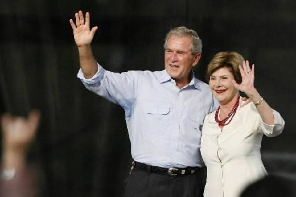 File photo - Former President George W. Bush and wife, Laura, were given a warm reception when they arrived at Woodward's July 4th celebration and re-dedication of Crystal Beach Park. Many of the 6,000 attending wore patriotic clothing and waved American flags. Photo by Jim Beckel