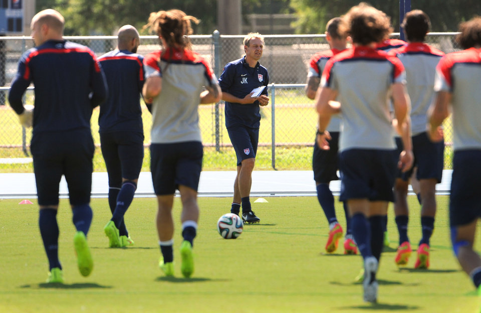 Photo - U.S. soccer head coach Jurgen Klinsmann, center, calls the team over for a talk before practice begins Wednesday, June 4, 2014 in Jacksonville, Fla.  The team was practicing in advance of Saturday's friendly match against Nigeria, the last before the World Cup matches in Brazil. (AP Photo/The Florida Times-Union, Bob Mack)