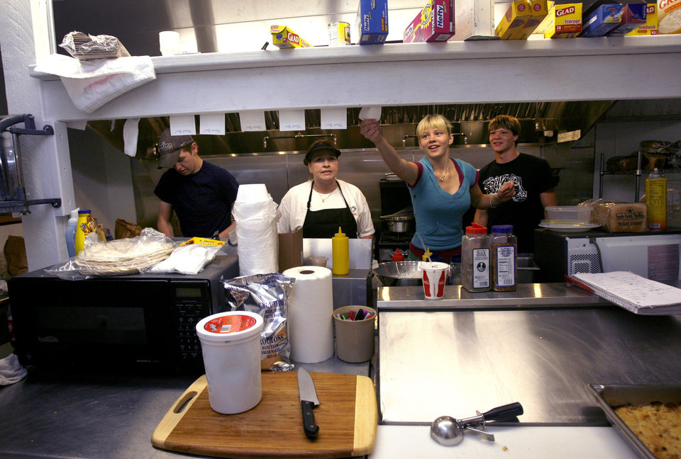 Alexis Herr, 14, puts up a ticket order Friday, May 29, 2009 in the kitchen at the Rock Cafe. Herr is the daughter of owner Dawn Longacre. Photo by Ashley McKee, The Oklahoman