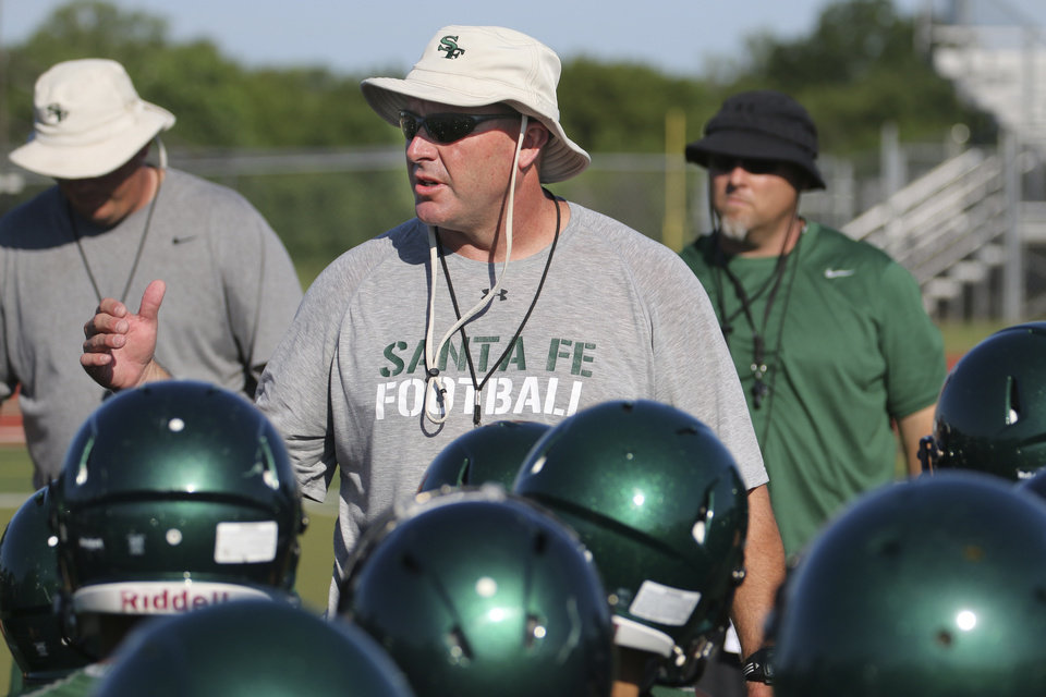 Photo - Santa Fe's head coach Lance Manning talks with the team during the first practice of the season in Edmond, Friday  August  11, 2014. Photo By Steve Gooch, The Oklahoman