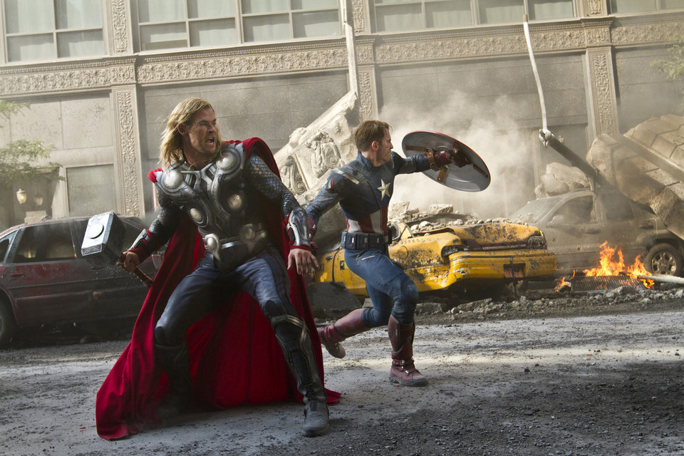 "In this film image released by Disney, Chris Hemsworth portrays Thor, left, and  and Chris Evans portrays Captain America in a scene from ""The Avengers,"" expected to be released on May 4, 2012. (AP Photo/Disney, Zade Rosenthal) ORG XMIT: NYET233"