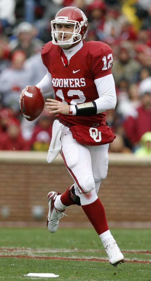 Photo - Oklahoma's Landry Jones (12) scrambles during a college football game between the University of Oklahoma Sooners (OU) and the Iowa State University Cyclones (ISU) at Gaylord Family-Oklahoma Memorial Stadium in Norman, Okla., Saturday, Nov. 26, 2011. Photo by Bryan Terry, The Oklahoman
