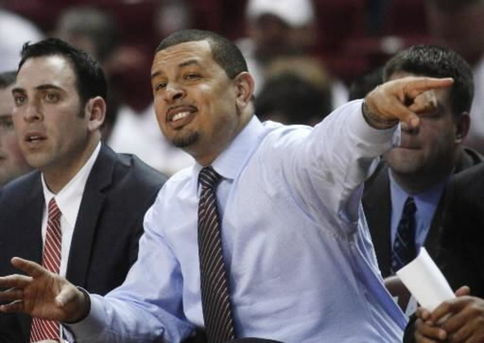 Oklahoma head coach Jeff Capel gestures to his team from the bench in the second half of an NCAA college basketball game against Texas in Norman, Okla., Wednesday, Feb. 9, 2011. Texas won 68-52. (AP Photo)