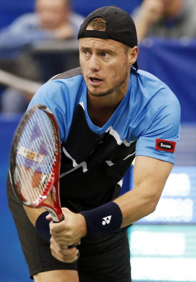 Photo - Lleyton Hewitt, of Australia, sets up for a return from Marcos Baghdatis, of Cyprus, in the second round match at the U.S. National Indoor Tennis Championships on Thursday, Feb. 13, 2014, in Memphis, Tenn. (AP Photo/Rogelio V. Solis)