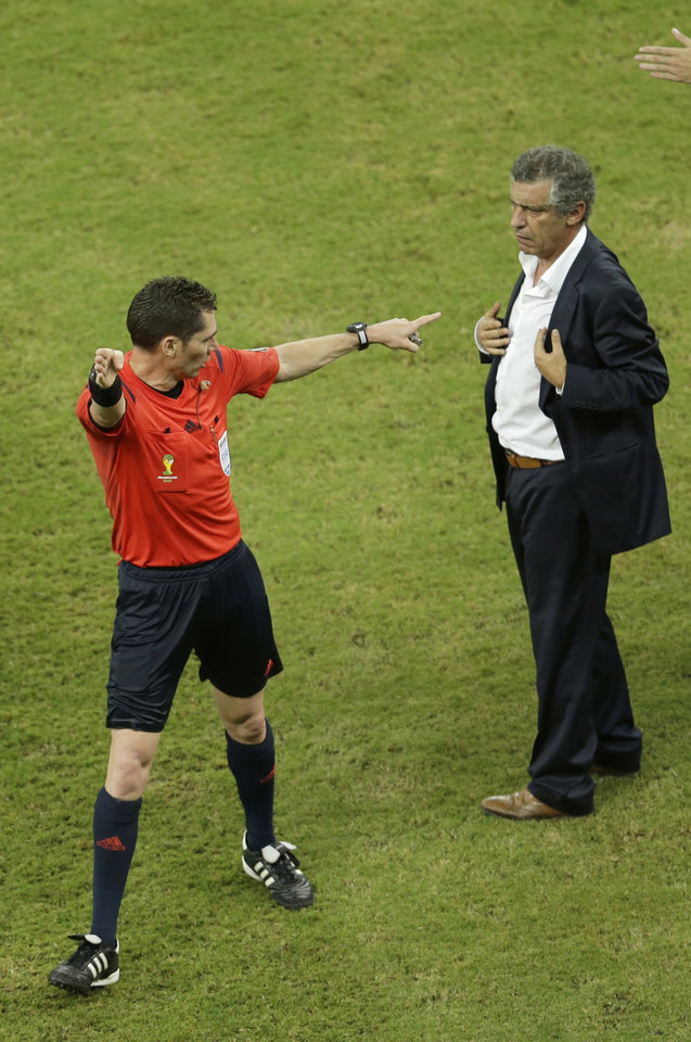 Photo - Referee Benjamin Williams from Australia sends Greece's head coach Fernando Santos off the field during the World Cup round of 16 soccer match between Costa Rica and Greece at the Arena Pernambuco in Recife, Brazil, Sunday, June 29, 2014. (AP Photo/Hassan Ammar)