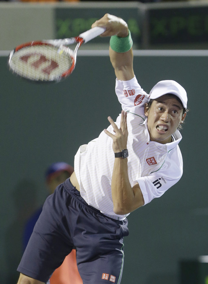 Photo - Kei Nishikori of Japan, serves to Roger Federer of Switzerland, at the Sony Open Tennis tournament, Wednesday, March 26, 2014 in Key Biscayne, Fla. (AP Photo/Wilfredo Lee)