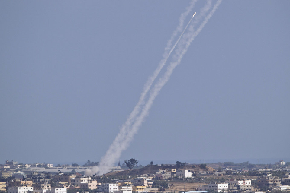 Photo - A rocket fired by Palestinian militants from in side Gaza Strip makes its way towards central Israel, seen from Israel Gaza Border, Wednesday, July 16, 2014.  A Hamas website says Israel has fired missiles at the homes of four of its senior leaders as it resumed bombardment of Gaza, following a failed Egyptian cease-fire effort. Wednesday's bombings came after Hamas rejected an Egyptian truce proposal on Tuesday and instead launched more rockets at Israel. (AP Photo/Ariel Schalit)