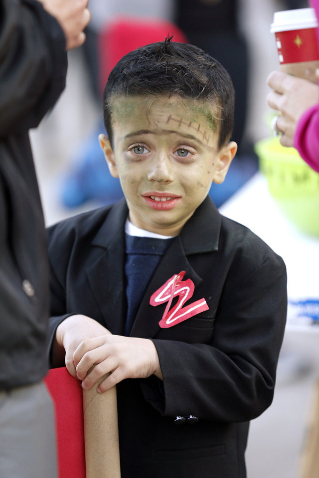 H.J. Gilman, 5, dressed as Frankenstein, participates in children�s activities at the annual Monster Dash sponsored by Junior League of Norman.  PHOTO BY STEVE SISNEY, THE OKLAHOMAN